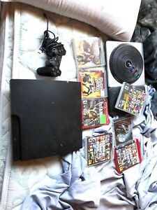 Ps3 with a controller and games