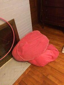 2 pink bean bag chairs