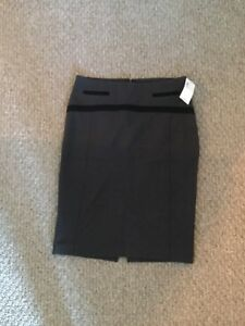 3 skirts, mint condition; one never worn with tags