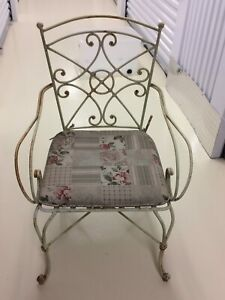 Two wrought iron chairs with cushion, $35 each