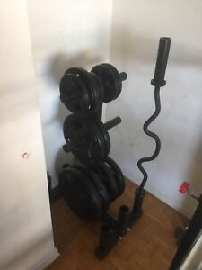 Bench press and weights and hex dumbells