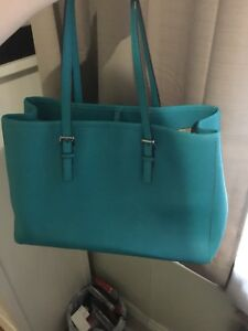 Mint condition teal green Michael Kors purse