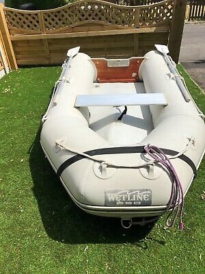 Inflatable boat with 2 older outboards
