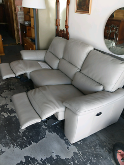 BRAND NEW FREEDOM RECLINING LEATHER COUCH