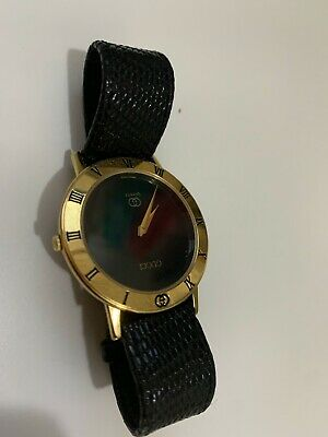 Gucci Vintage Gold Watch Gold Face Black Leather Band Needs Battery and glass.