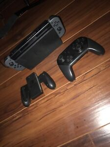 Black Nintendo switch with pro controller