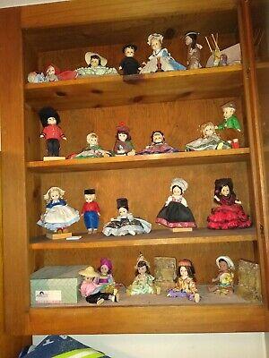 """21 8"""" Madame Alexander dolls"""