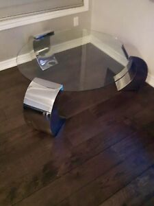 Luxurious glass and metal coffee table for sale