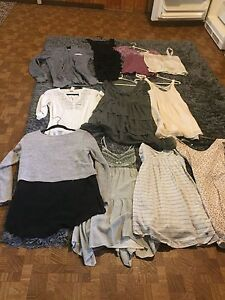 Brand name clothes , lightly used .