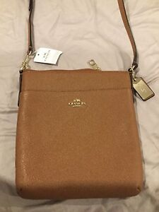 Brown Coach leather cross body bag