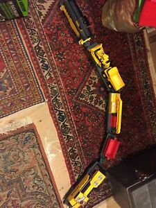 Battery operated train with detachable cars and trucks