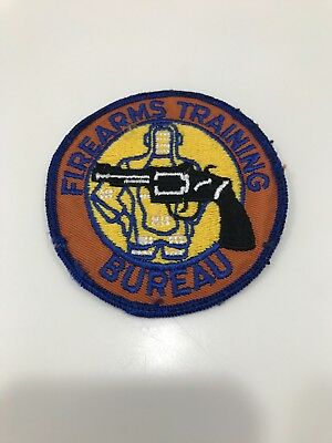 Firearms Training Bureau On Orange Twill Patch