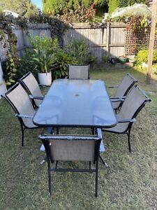 1 outdoor table and 6 comfortable chairs