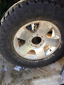 20 inch Ford factory rims for F350, 8 bolt pattern.