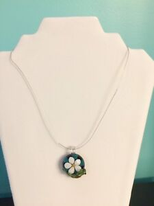 Lovely glass flower pendant with lizard on the side