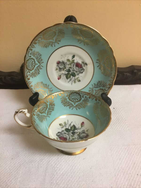 Paragon Fine Bone China Cup And Saucer Blue With Gold Trim With Roses