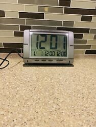 Brookstone Dual Alarm Clock Large LCD Automatic Night Backlit Calendar Clock
