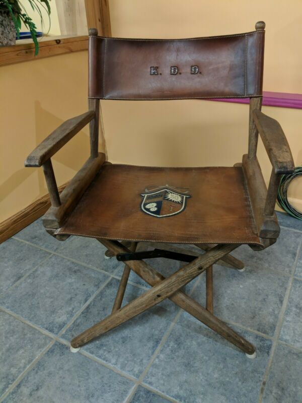 VINTAGE LEATHER DIRECTORS CHAIR  with Very Unusual Logo