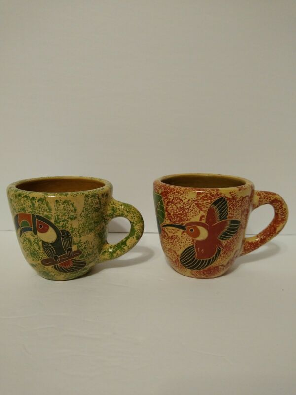 Pair of vintage art pottery tropical bird mugs from Nicaragua