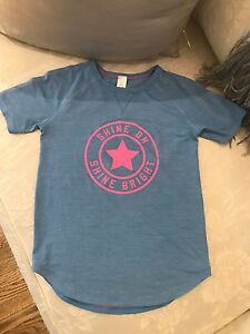 Ivivva T- Shirt Baby blue and pink writing  size 6