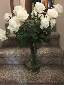 Large vase with artificial white roses