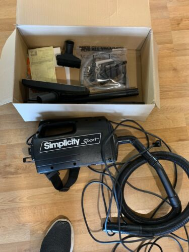 SIMPLICITY SPORT HANDHELD CANISTER VACUUM WITH ACCESSORIES AND ORIGINAL BOX BLA