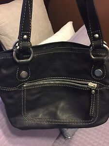 Several purses. Various styles