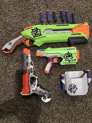 Lot of 3 Nerf Guns 1 Zombie Strike Pistol 1 Sharpfore Pistol And 1 Rough Cut 2x4