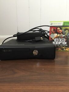 Xbox  360 console with red dead redemption