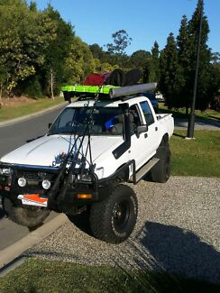 1995 dual cab hilux twin locked and lifted Highland Park Gold Coast City Preview