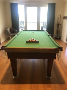 Pool table complete with full set of balls & cues with stand.
