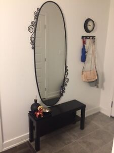 IKEA's mirror, bench with accessories, wall clock and hanger.