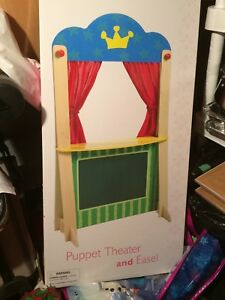 Un-opened puppet theatre with chalkboard