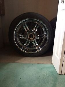 """24"""" Dodge Ram rims and tires."""