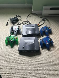 Two Nintendo 64's and 4 controllers