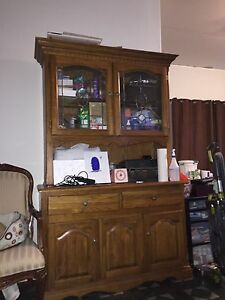Solid oak hutch with glass doors and light