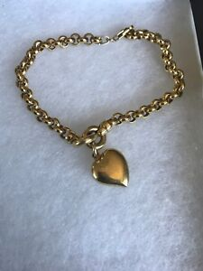 gold bracelet with heart pendant