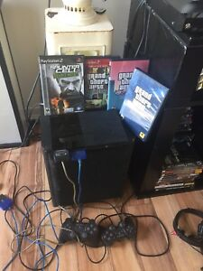 PS2 Slim (multi tap accessory) $300.00
