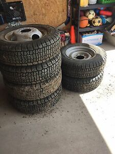 6 like new tires on rims for sale
