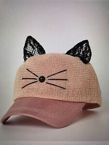 Pink hat. Sweet cat.