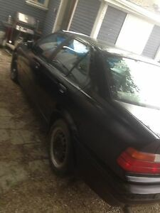Saftied BMW 93 320i with 93 318i parts car