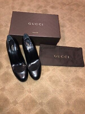 women black leather gucci high heels