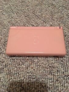Pink Nintendo DS  lite with extra pen, charger and 7 games