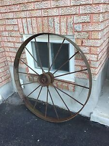 A pair of large antique iron wheels