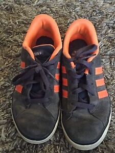 Two pairs of name brand shoes Youth size 4
