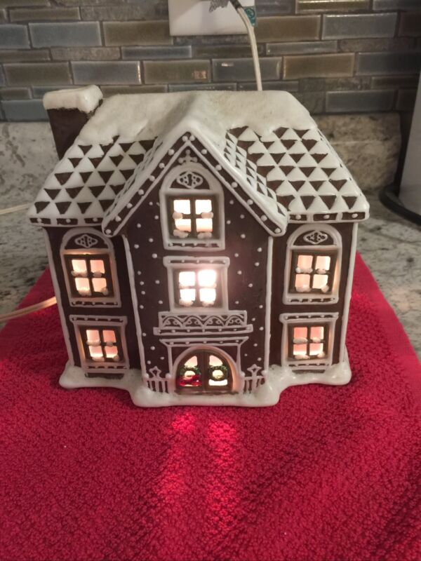 Snow covered Ceramic Lighted House With Christmas Wreaths