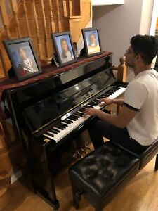 Perfect condition tomson piano with pictures