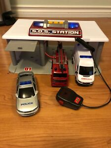 Toy SOS station with police car, ambulance, and fire truck