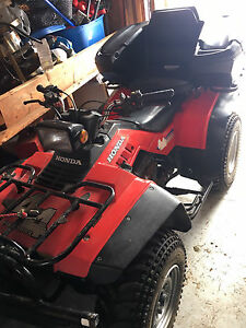 Excellent condition ATV with plow!