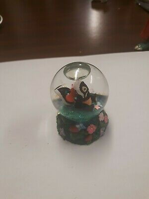 Disney mini snow globe featuring Bambi's pal Flower (skunk)Holding A Heart.
